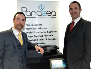 Panacea Directors Standing By A Photocopier